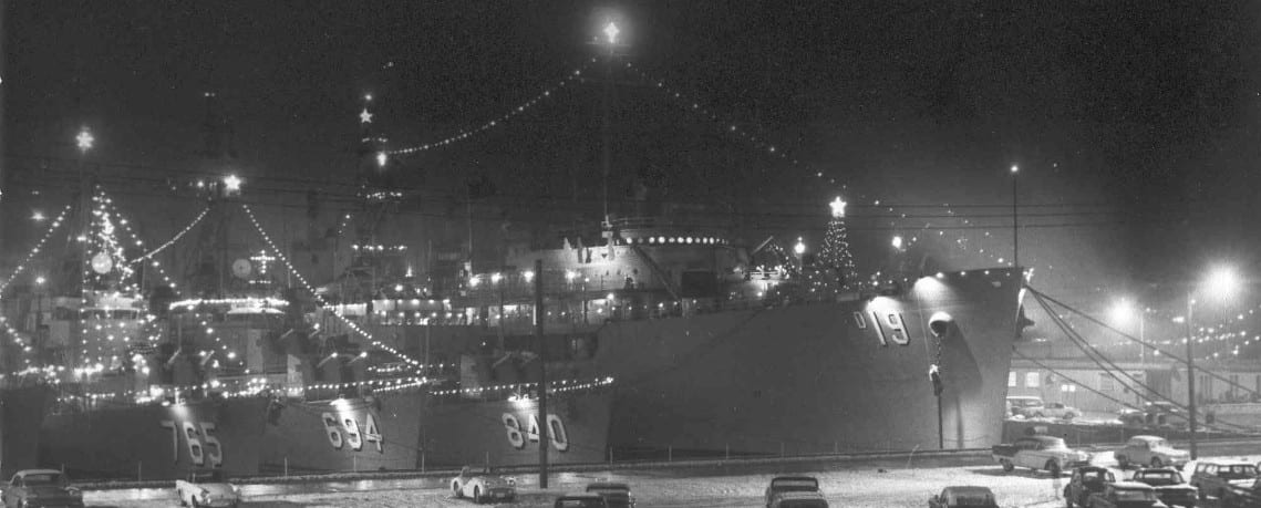 Uss Yosemite docked at christmas 1962 decorated