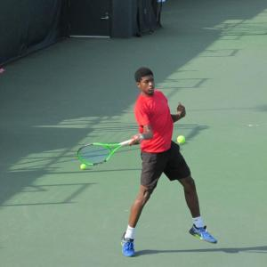 Mikeal Carpenter, Junior Player Scholarship recipient, Playing Tennis