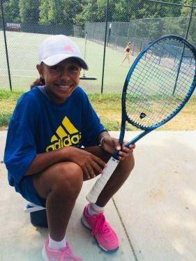 Andrea Vargas playing tennis at adidas summer camp