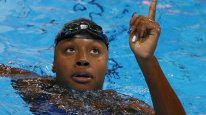 2016 Rio Olympics - Swimming - Final - Women's 100m Freestyle Final - Olympic Aquatics Stadium - Rio de Janeiro, Brazil - 11/08/2016. Simone Manuel (USA) of USA reacts after winning the gold and setting a new Olympic record. REUTERS/Marcos Brindicci TPX IMAGES OF THE DAY FOR EDITORIAL USE ONLY. NOT FOR SALE FOR MARKETING OR ADVERTISING CAMPAIGNS.