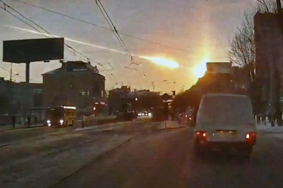 A meteorite flashes across the sky over Chelyabinsk, Russia, taken from a dashboard camera.