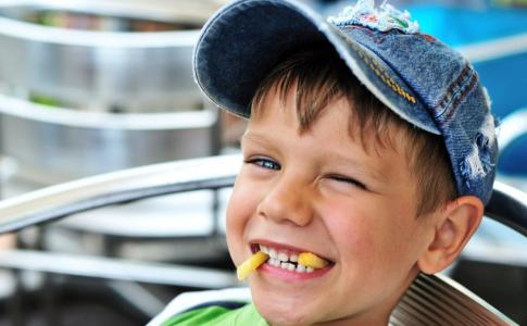 little-boy-enjoying-french-fries[1]
