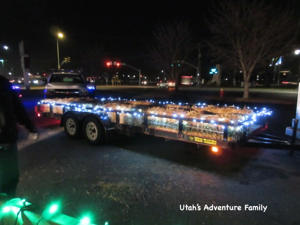All of the wagons are decorated with lights and are pulled by trucks!
