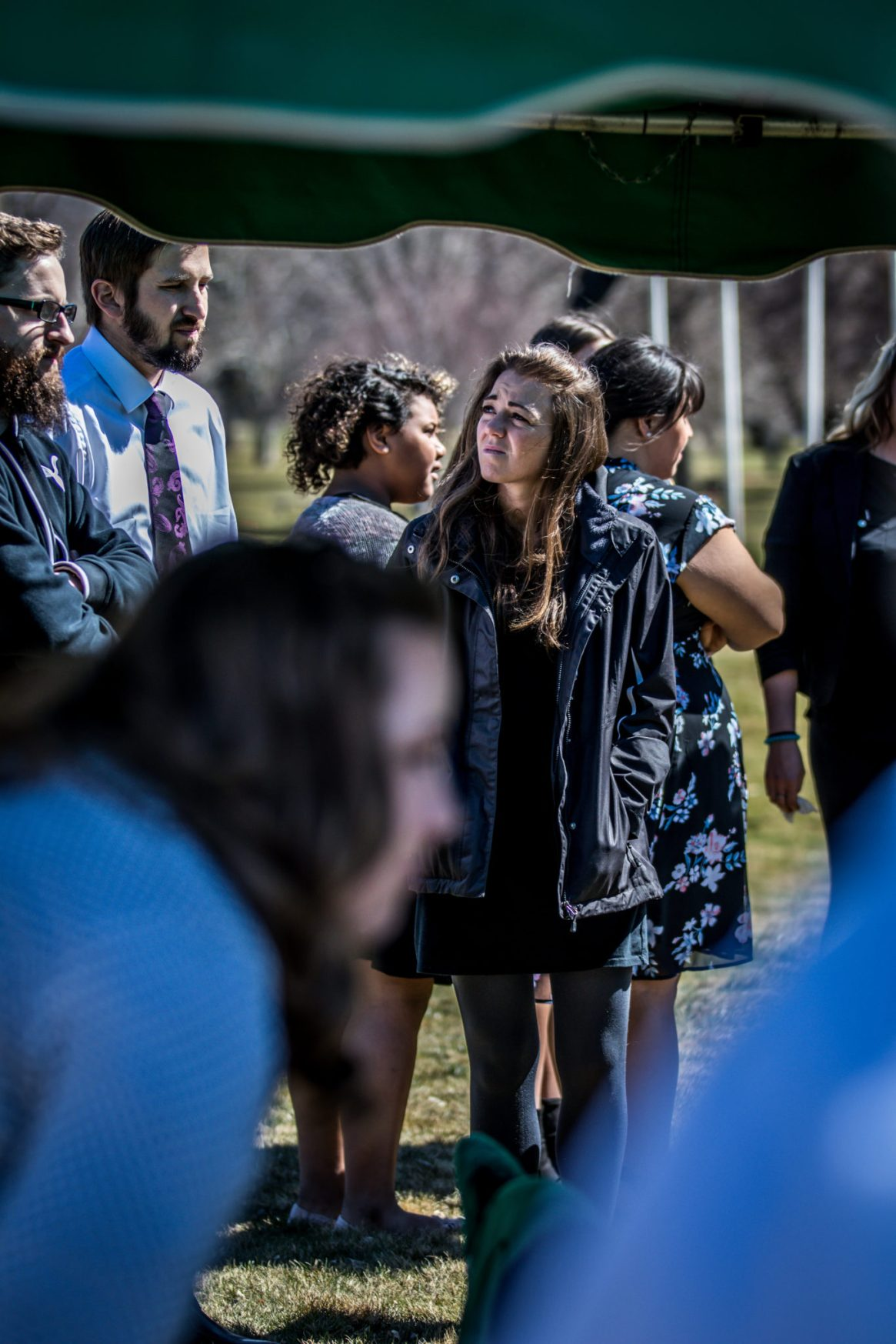 confused sad friend at mom's funeral cemetery photography for funerals Ryan hender films