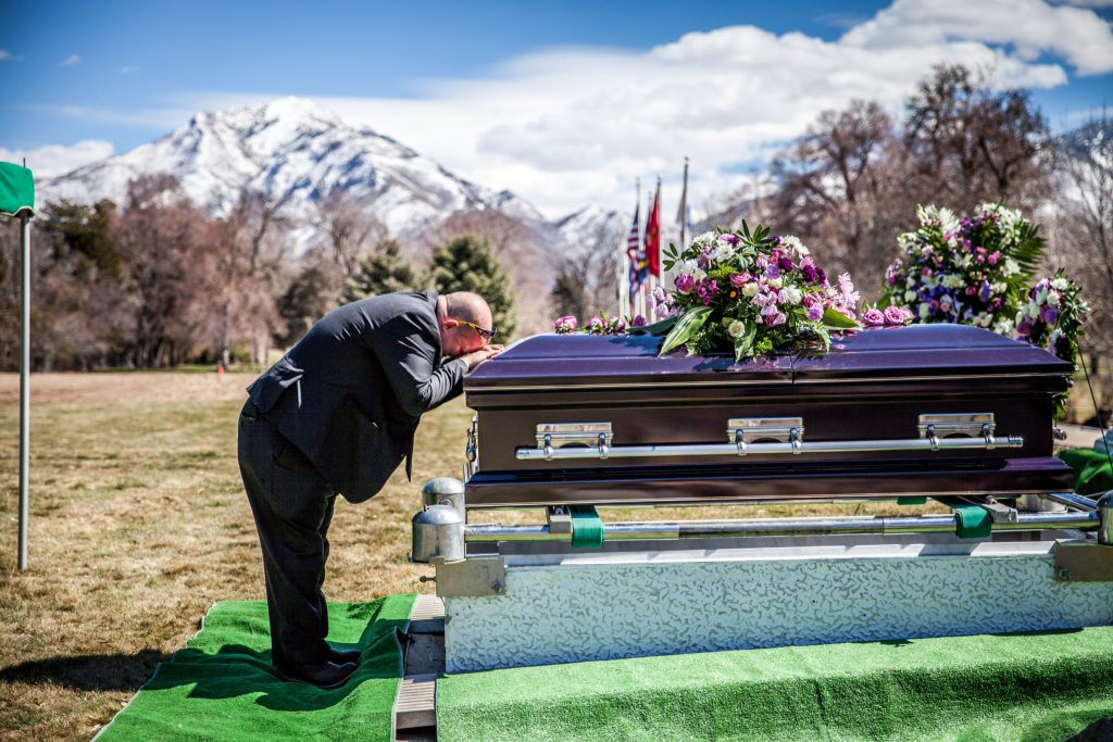 kissing casket Wasatch lawn salt lake city cemetery photography for funerals Ryan hender films
