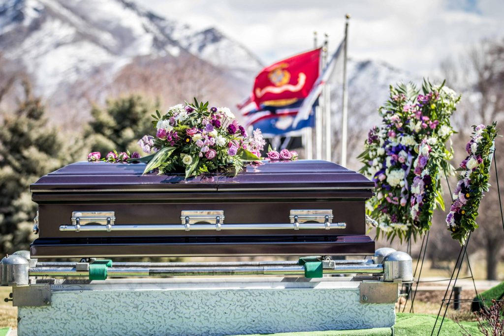 casket in final resting place Wasatch lawn salt lake city cemetery photography for funerals Ryan hender films