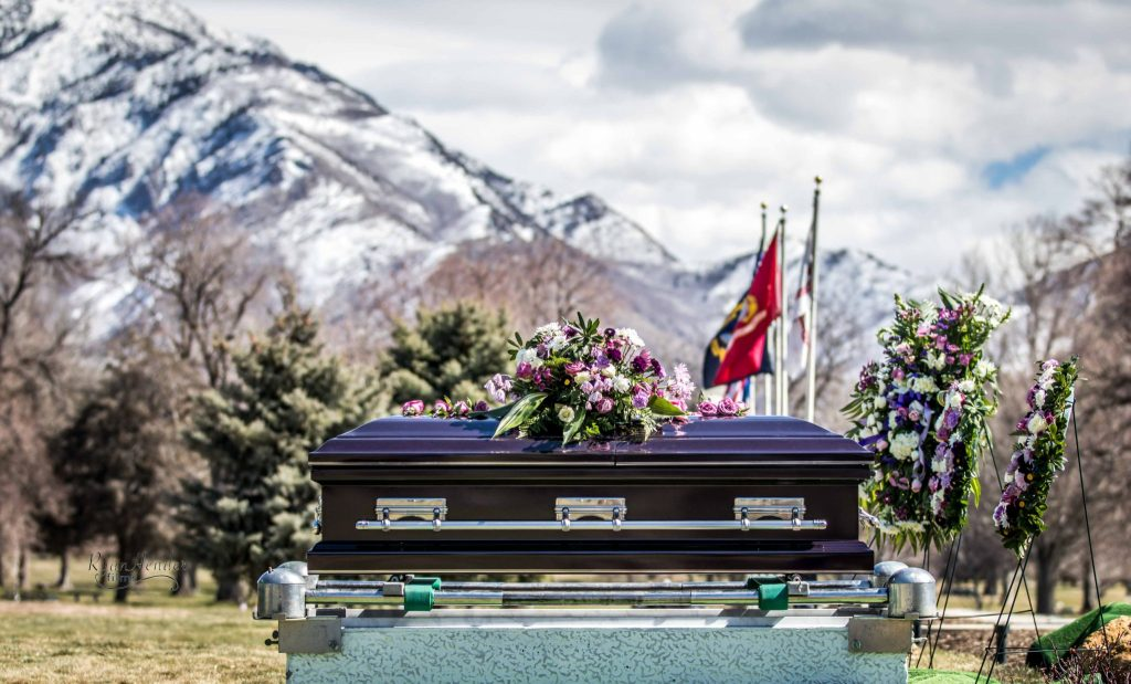 casket with mountains in background Wasatch lawn salt lake city cemetery photography for funerals Ryan hender films