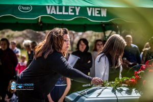 sister placing rose on casket funeral service salt lake city utah Ryan hender photography