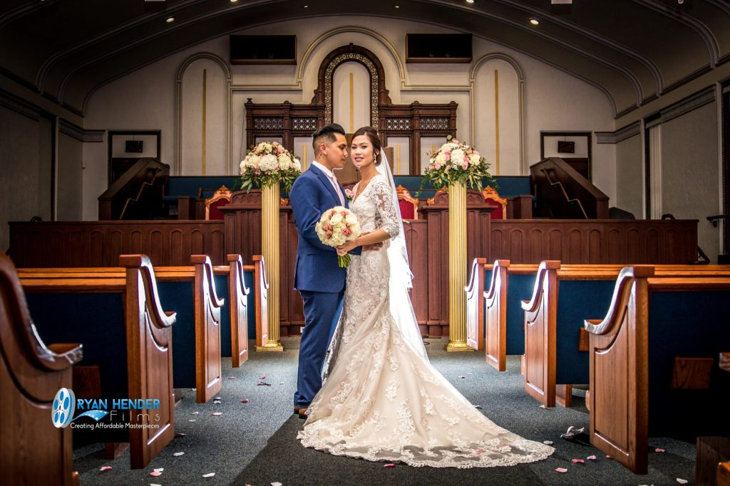 bride and groom in church after wedding ceremony