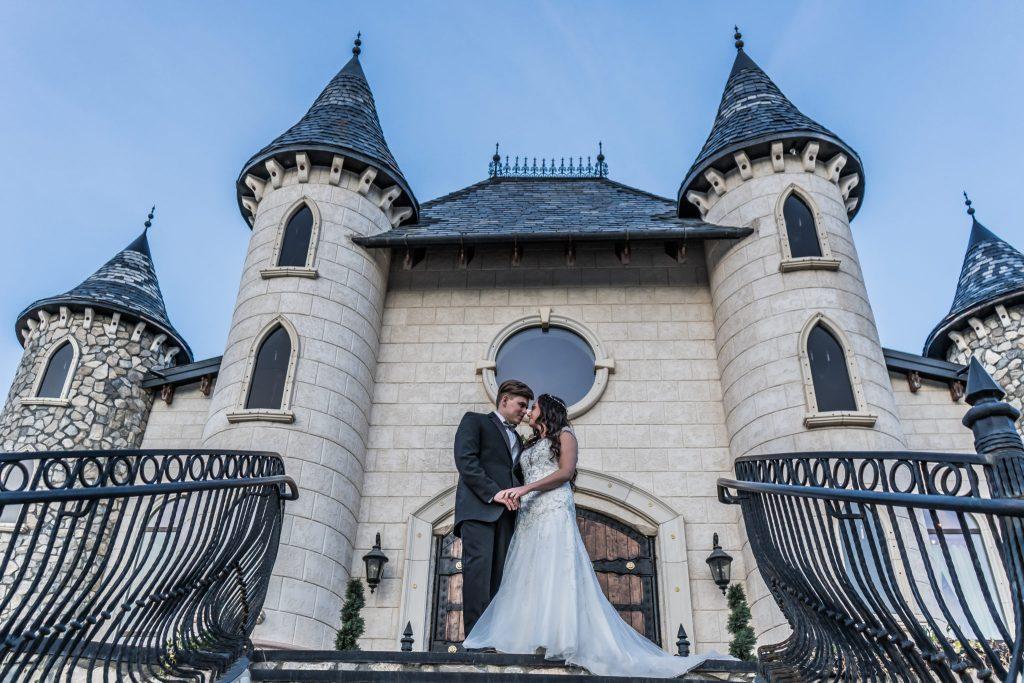 bride and groom on steps at wadley farms wedding venue utah wedding videography