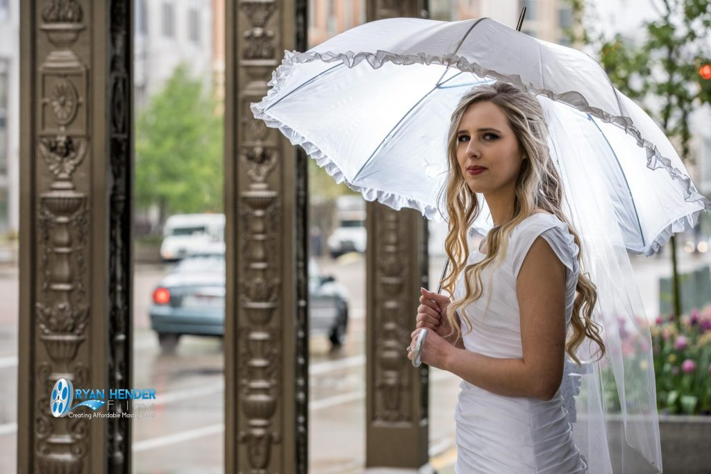 rainy wedding bride umbrella wedding photography