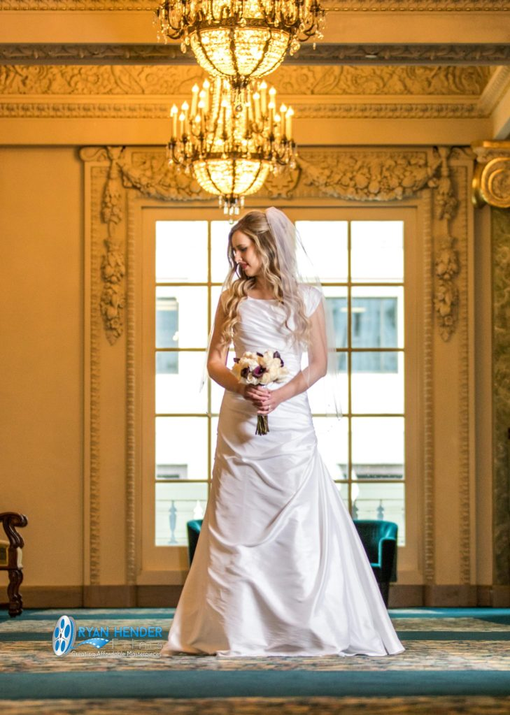 wedding photography bride holding bouquet in hallway