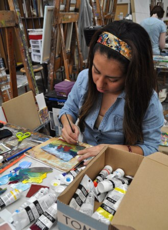Art junior Fabiola Valenzuela works on a project during the Department of Art & Art History's open house Jan. 31.