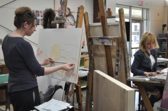 Art majors work on painting assignments during the Department of Art & Art History's open house Jan. 31.