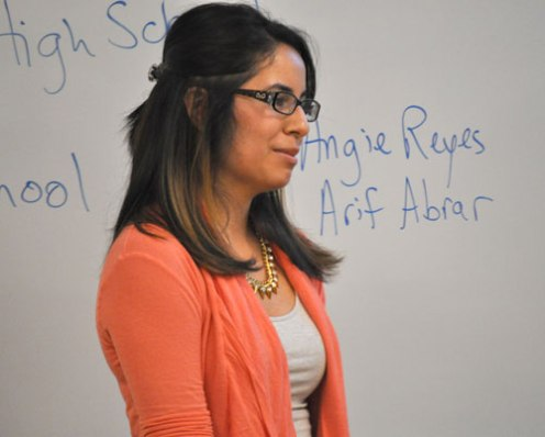 Junior political science major Angelica Hernandez Reyes, a pre-Law student, chats with Arlington ISD students during an April 2 workshop on the UT Arlington campus. Abrar will participate in the Archer Fellowship program next year. (Photo by James Dunning)