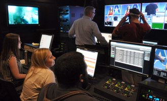 Students rehearse a news broadcast in the Department of Communication's newly renovated control room. (James Dunning/COLA Communications)