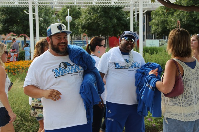 """Two Mavs """"Maniaacs"""" helped pass out shirts at """"Love in the Streets"""" that read, """"#DallasStrong."""""""
