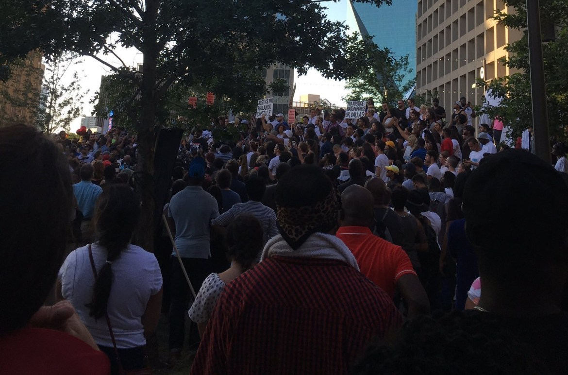 Protesters gathered peacefully on July 7 to recognize cases of police brutality and injustice in the immediate aftermath of the shootings in Baton Rouge, LA and Falcon Heights, Minn. Photo by Angelicque Roa.