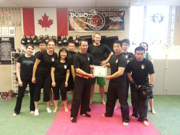 Warren Gets his orange Belt Cert