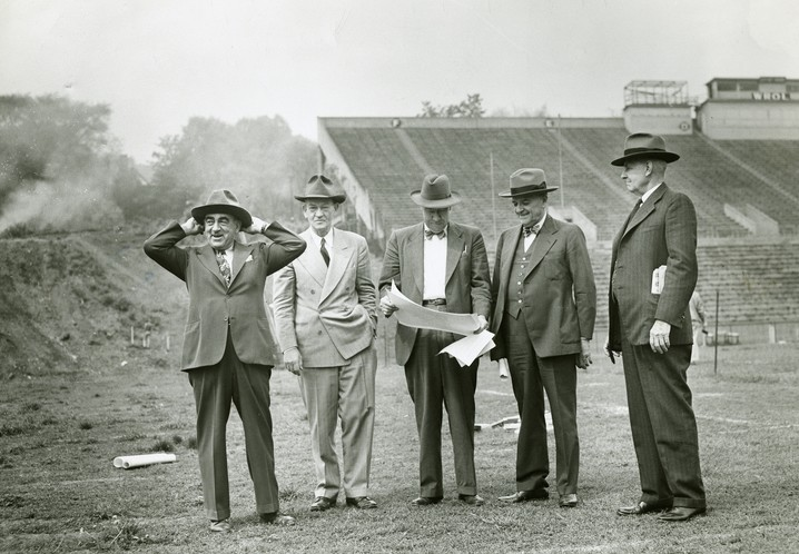 Group of men pictured standing on football field
