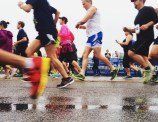 Like the rainfall, runners poured across the starting line at the sound of the buzzer.