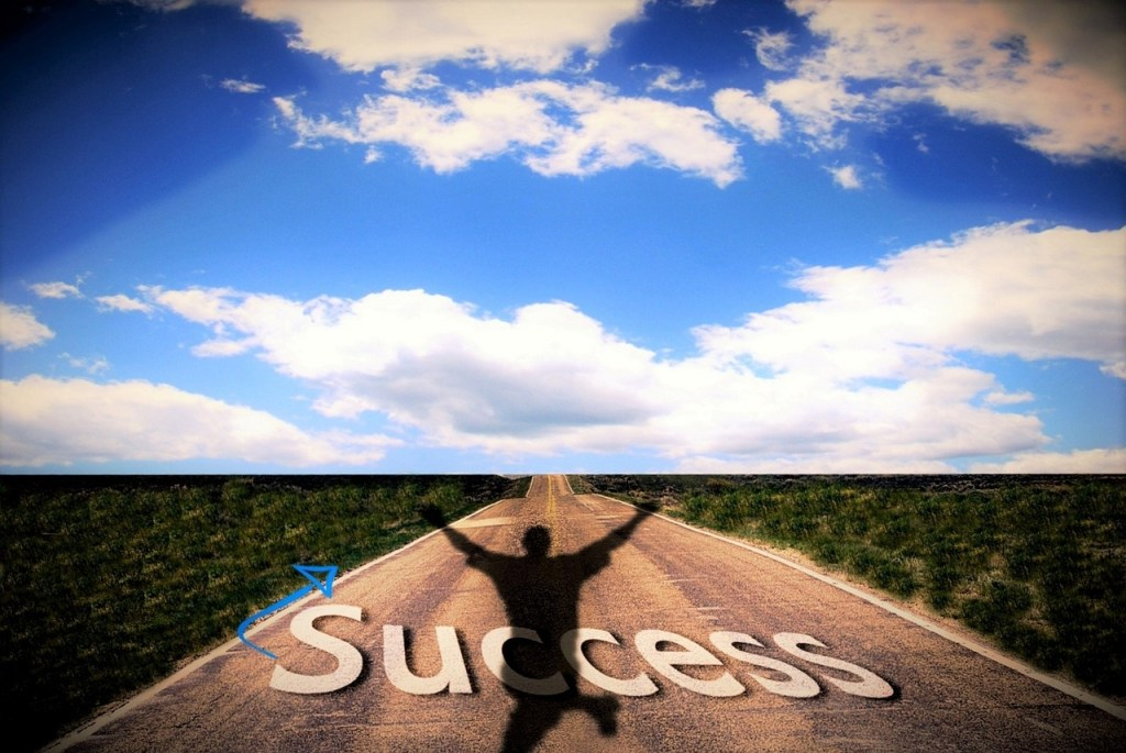 road with man and success written on it