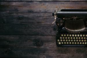Antique Typewriter on Dark Wood