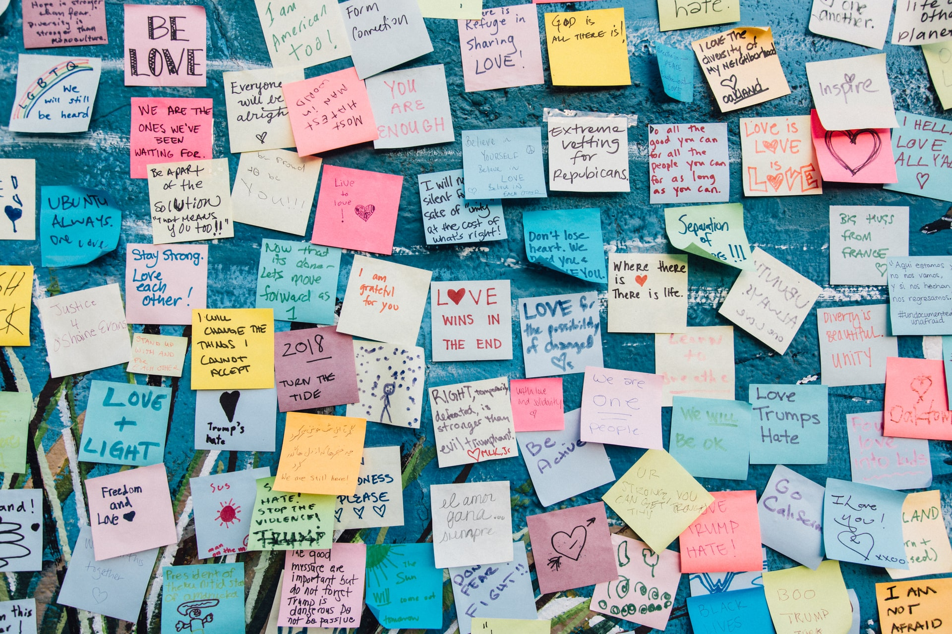wall covered with sticky notes containing notes about love