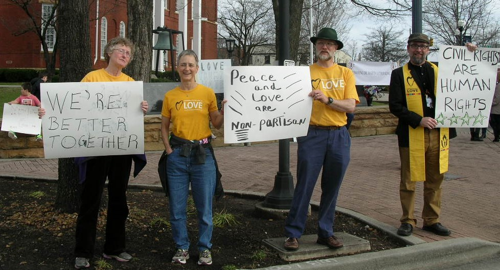 Members Susie, Susan, Ivan, and Minister Mark Pafford holding signs at a protest in front of the Putnam County Courthouse in Cookevill, TN