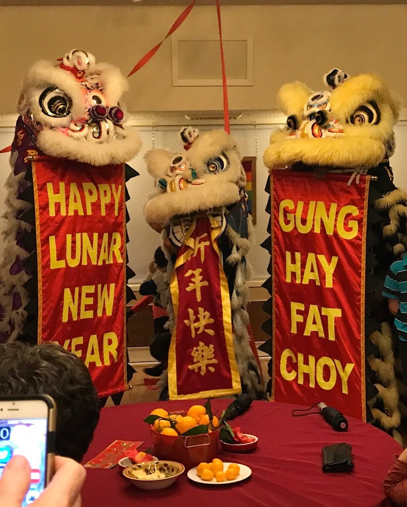 Three lions with banners in their mouths: Happy Lunar New Year