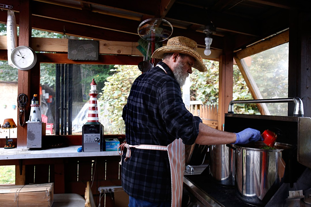 Jeff Bartlett, of White River Junction, Vt., adds jalapeno peppers to two 22-quart pots of his medium-hot salsa on the deck of his home on Sept. 29, 2017. Once a week, Bartlett cooks about a dozen cases of salsa over a 12-hour period. Jeff and Lori Bartlett started selling four varieties of Tex's Best Salsa in stores in August. (Valley News - Geoff Hansen) Copyright Valley News. May not be reprinted or used online without permission. Send requests to permission@vnews.com.