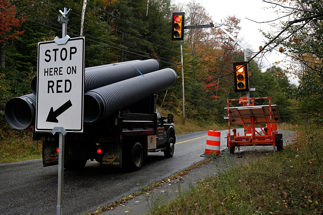Photographed on Oct. 6, 2017, traffic on Route 132 between Strafford, Vt., and Norwich, Vt., has been slowed by three temporary traffic lights due to a lane closure in three locations. The roadway has been damaged by the July 1 flooding of the Ompompanoosuc River. (Valley News - Geoff Hansen) Copyright Valley News. May not be reprinted or used online without permission. Send requests to permission@vnews.com.