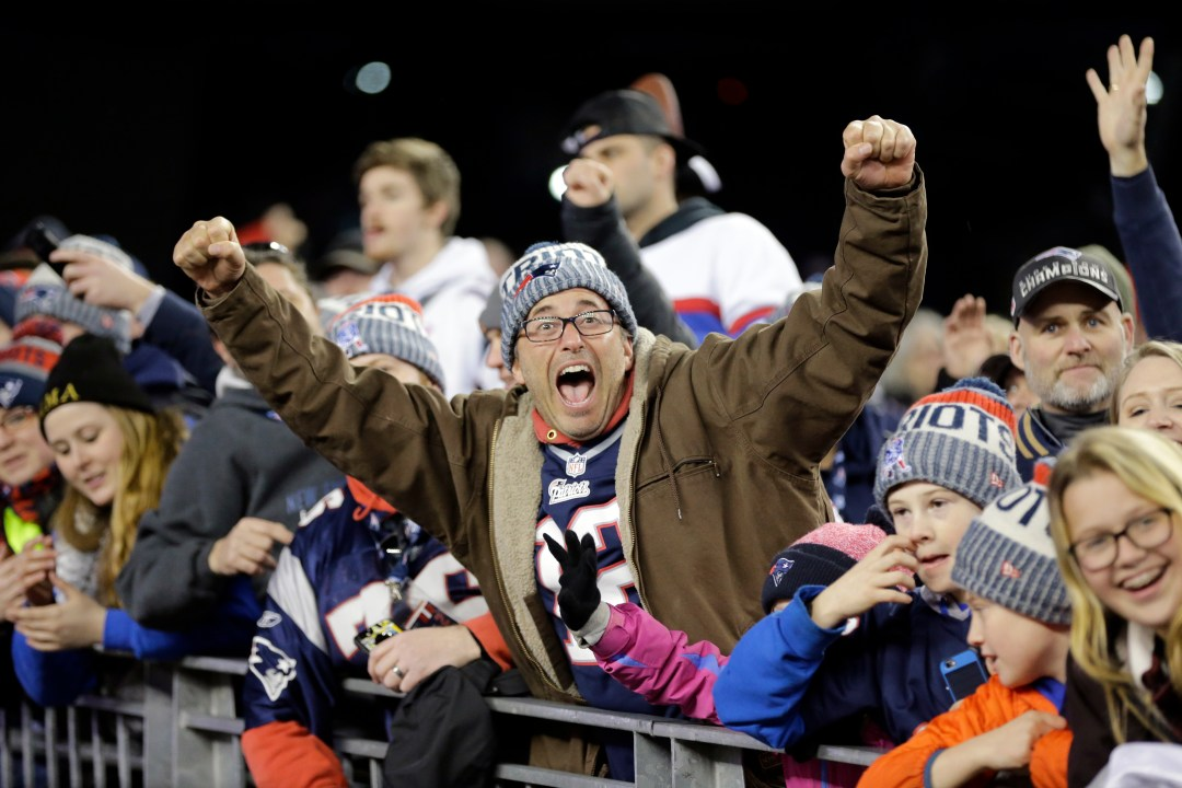 New England Patriots fans cheer as the players walk off the field after the AFC championship NFL football game against the Jacksonville Jaguars, Sunday, Jan. 21, 2018, in Foxborough, Mass. The Patriots won 24-20. (AP Photo/David J. Phillip)