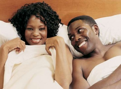 awkward-black-couple-bed-getty-images