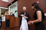 Dean Rick Morin presents Soraiya Thura '18 with a new Larner College of Medicine white coat.