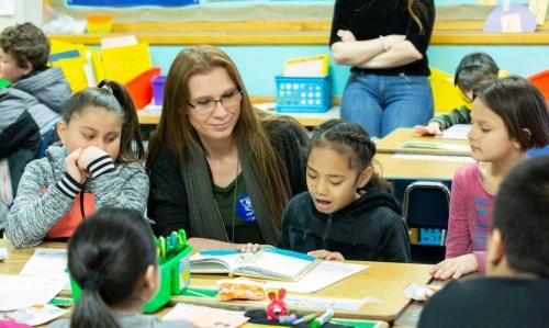 United Way of Salt Lake reading with volunteers