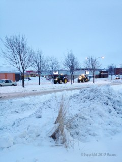 Clean up: Snow trucks hard at work in the early AM