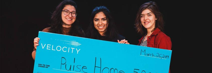 Pulse Home team members smile with their Velocity cheque