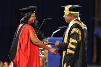 Chancellor granting the Doctor of Philosophy Degree...(see http://tinyurl.com/chill-facebook)