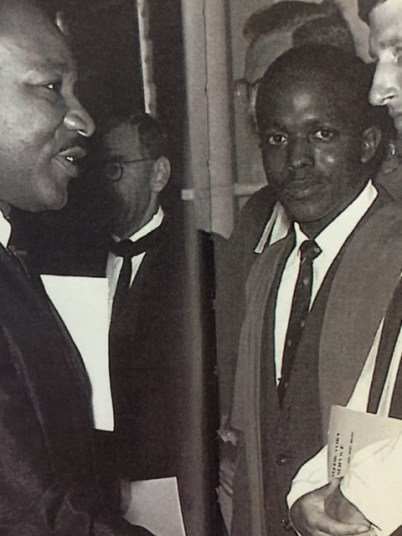 Medical student and Chapel committee rep E. Anthony Allen waits to shake hands with Rev Dr Martin Luther King (left) at UWI on June 20, 1965 (Detail from Ken Richards photo)