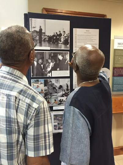 UWI students of the 1960s, now Professors Emeritus, look at photos from June 20, 1965. At left, Patrick Bryan; at right Rupert Lewis.