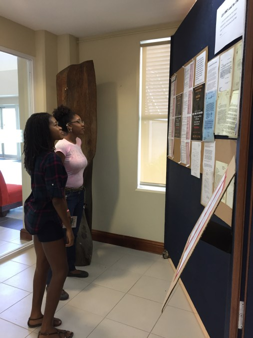 Students checking out the pop-up exhibit at the UWI Museum