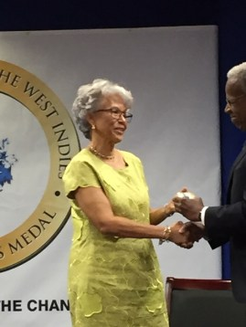 Prof Leo-Rhynie receives her award from Chancellor Alleyne