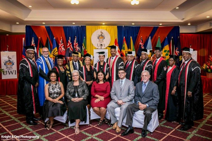 Dr. Luz Longsworth (standing centre) with members of The UWI Senior Management Team (standing) and her family and friends (seated).