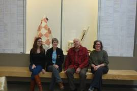 Sarah, Allison, Brian, and Johnna Buysse, curator of collections and education at the Mount Horeb Area Historical Society, pose in front of the exhibition (Not pictured is Kaylyn Gerenz)
