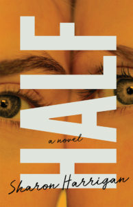 Orange book cover with twin faces partially shown.
