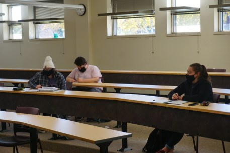 Students wearing masks in Swenson classroom