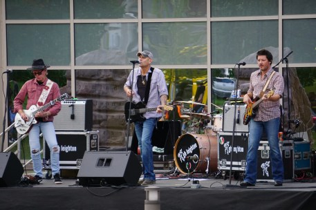 """To close the day of activities for the """"Day of Welcome"""" the rock group GB Leighton performed outside of the Yellow Jacket Union. Lead singer Brian Leighton (center), guitarist Patrick Tanner (left), drummer Ryan Inselman (not pictured) and bassist Dave Crowell put on a performance that featured covers of popular classic rock songs."""