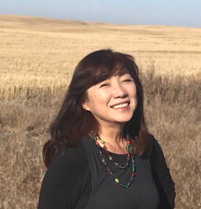 Machiko, Administrator and Counsellor, in a wheat field