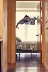 a man hovering above a bed